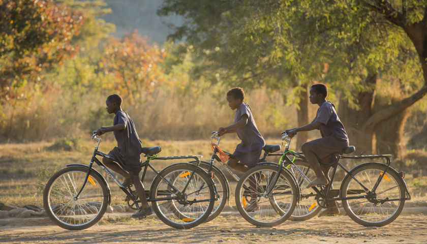 kids biking in Africa